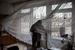 Окна с выбитыми в результате обстрела стеклами