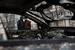 Искореженные автомобили на одной из улиц Мариуполя после обстрела города
