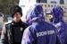 Полицейские, переодетые на Олимпиаде в форму от Bosco без знаков различия (справа) и казак - дружинник