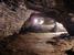 Ахштырская пещера                                      В село Ахштырь стоит заехать, если собираешься на машине в Красную Поляну. Неподалеку от села есть уникальная Ахштырская пещера, которая упоминается в учебниках истории. Именно здесь открыли самую северную в Европе стоянку первобытного человека. 70 000 лет назад здесь жили неандертальцы, 30 000 лет назад - кроманьонцы. Однако теперь пещера - не единственная достопримечательность Ахштыри. Село прославилось своим карьером, где велась добыча известняка для олимпийских строек, а теперь карьер превратился в свалку твердых отходов и бытового мусора.