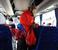 По дороге в автобус к факелоносцам проникает бойкий представитель компании Coca-Cola (она партнер олимпийской эстафеты) и одаривает всех баночками с напитком.