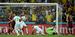 Алжирец Ислам Слимани (в центре) забивает гол