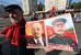 Участник шествия коммунистов в день международной солидарности трудящихся на Большой Якиманке в Москве