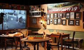 Реконструкция кафе в Бастони, которое оказалось в зоне бомбардировок