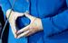 Руки канцлера, сложенные в традиционный для нее ромб. Этот ромб - гармонизация противонаправленных сил в стабильную конструкцию