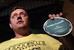 """Член фракции Госдумы """"Справедливая Россия"""" Олег Пахолков с наклейкой, найденной сотрудниками полиции  квартире, где прошел обыск."""