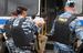 Сотрудники правоохранительных органов задерживают мужчину во время рейда по проверке документов на территории Кунцевского рынка в Москве