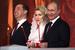 Президент Владимир Путин (справа) и премьер Дмитрий Медведев (слева) с супругой Светланой на пасхальном богослужении в храме Христа Спасителя