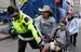 27-летний Джефф Бауман ждал на финише подружку, которая бежала марафон. Взрывом ему оторвало обе ноги. Очнувшись после операции, он попросил бумагу и написал, что виде человека, который положил на асфальт сумку и эта сумка взорвалась. Позже он помог ФБР, описав внешность подозреваемого.