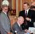 1999 г.                                          Министр финансов Михаил Касьянов, министр экономики Андрей Шаповальянц и представителя президента по делам «Большой восьмерки» Александр Лившиц (справа налево).