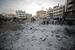 Место взрыва израильской ракеты в одном из жилых кварталов Газы