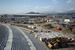 """Вид на олимпийский парк. Ступени Большой ледовой арены (на первом плане) и конькобежный центр """"Олимпийский Овал"""" в Имеретниской долине."""