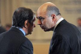 Президент «Роснефти» Игорь Сечин (слева), кажется, наконец нашел общий налоговый язык с министром финансов Антоном Силуановым