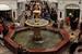 Фонтан в ГУМе - исторический памятник, сооружен в 1906 г. Первоначально чаша фонтана была круглой и выполнена в виде купола. Свою нынешнюю, восьмиугольную, форму она приобрела в 1958 г. во время реконструкции. Опора фонтана была сконструирована и изготовлена в начале ХХ века специально для Верхних торговых рядов и сохранилась до наших дней. По таким конструкциям рассчитывались купола при строительстве церквей
