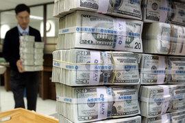 Укрепление доллара путает планы ФРС США