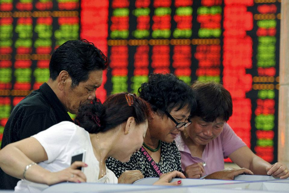 Крупные инвесторы недовольны системой квот, по которой они покупают акции в Шанхае