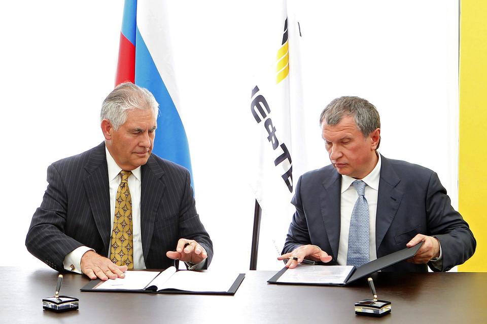 Гендиректор ExxonMobil Рекс Тиллерсон (на фото – слева) позвал Игоря Сечина (справа) в Африку