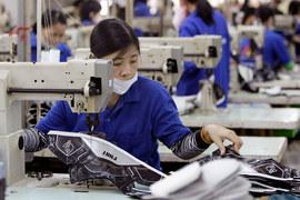 Привлекательности Вьетнама способствует и стремительный рост оплаты труда и нехватки рабочих в Китае
