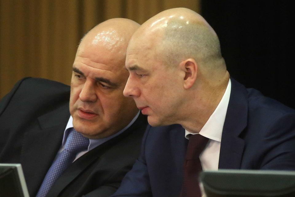 Министр финансов Антон Силуанов (на фото справа) и руководитель ФНС Михаил Мишустин договорились, как собирать страховые взносы