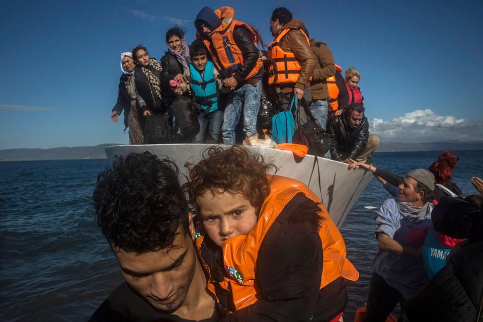 Беженцы на берегу Греции