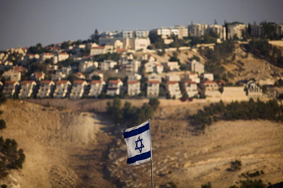 23 декабря 14 из 15 членов СБ ООН одобрили резолюцию, требующую прекратить строительство на оккупированной с 1967 г. палестинской территории израильских поселений