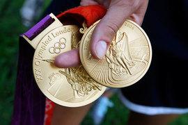 МОК постановил, что нарушители должны сдать олимпийские медали и другую атрибутику, завоеванные на Олимпиадах 2008 г. и 2012 г.