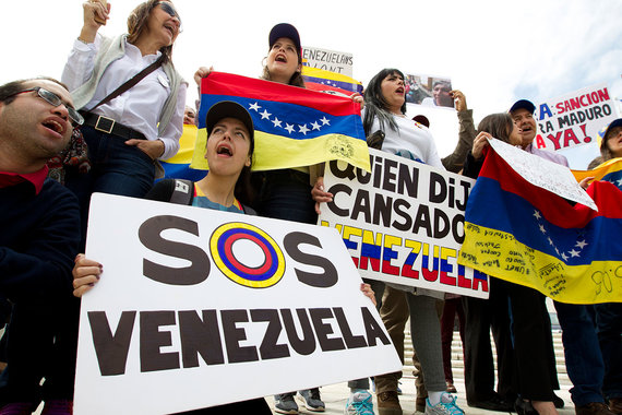 Неуплата долга России грозит Венесуэле дефолтом