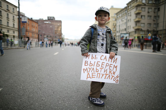 Участник митинга