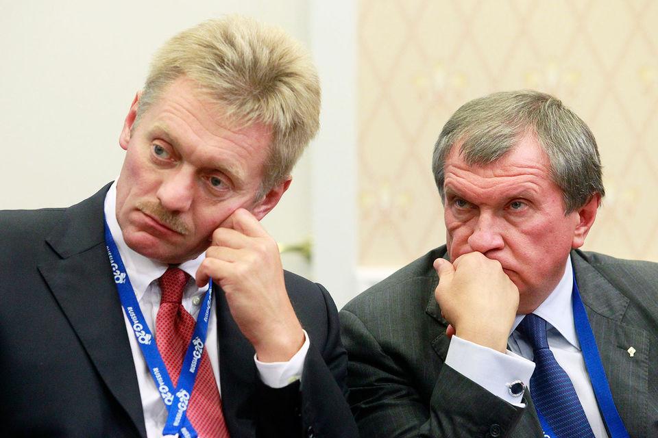 Пресс-секретарь российского президента Дмитрий Песков и главный исполнительный директор «Роснефти» Игорь Сечин