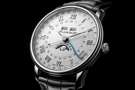 Villeret Quantième Complet GMT - пополнение в классической коллекции Blancpain. Часы с функцией мирового времени оснащены новым запатентованным усложнением для повышения точности