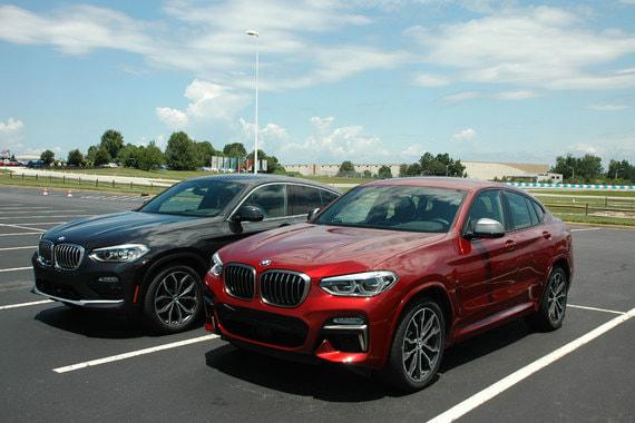 Хорошо видна разница американской (темно-серая Xdrive 30i)  и европейской (красная M40d) версий X4