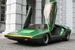 В той же Alfa Romeo в сотрудничестве с тем же ателье Bertone родился и еще один способ открывания дверей вверх, получивший название «ножницы». Концепт-кар с «ножницами» по имени Carabo («жужелица» по-итальянски) создал Марчелло Гандини. Причина была чисто утилитарная: из этого концепта был настолько плохой обзор, что для движения назад нужно было высовываться из него, и, чтобы не создавать помех окружающим, Гандини предложил сдвигать двери вертикально вверх