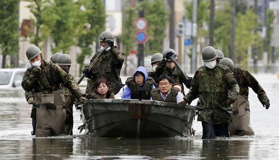 Последствия сильнейшего наводнения в Японии и Китае